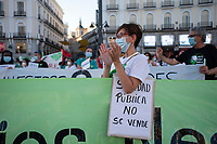 MADRID, SPAIN - JUNE 29: A woman applauds  during a protest held in the afternoon in Puerta del Sol to request better working conditions, protection equipment and investment in Health to fight against the covid-19 on June 29 2020, in Madrid, Spain. The region of Madrid was the main focus of covid-19 outbreak in Spain. In al over the country, more than 50000 thousand health staff has been infected with the coronavirus since the beginning of the pandemic.(Photo by Sergio Belena/VIEWpress via Getty Images).