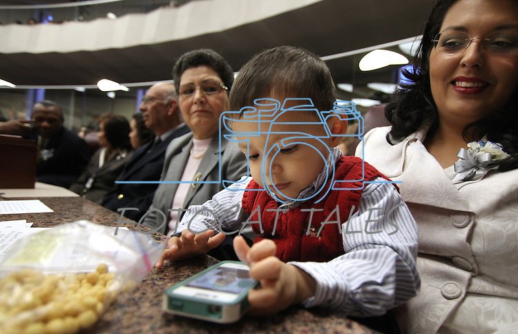 Nevada Assemblywoman Olivia Diaz, D-North Las Vegas, right, watches her son Xavier Carson Alejandre during the opening day of the 77th Legislative Session in Carson City, Nev. on Monday, Feb. 4, 2013. <br /> Photo by Cathleen Allison