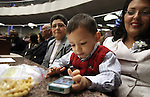 Nevada Assemblywoman Olivia Diaz, D-North Las Vegas, right, watches her son Xavier Carson Alejandre during the opening day of the 77th Legislative Session in Carson City, Nev. on Monday, Feb. 4, 2013. <br />