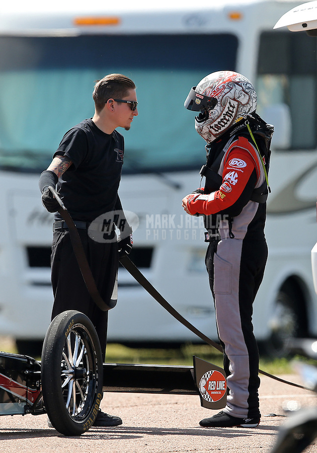 Apr. 28, 2013; Baytown, TX, USA: NHRA crew member for top fuel dragster driver Steve Torrence during the Spring Nationals at Royal Purple Raceway. Mandatory Credit: Mark J. Rebilas-