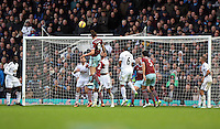 Sunday 07 December 2014<br /> Pictured: Andy Carroll (9) of West Ham is heading the ball in, his second goal<br /> Re: Premier League West Ham United v Swansea City FC at Boleyn Ground, London, UK.