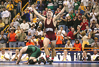 20 MARCH 2004:  Stanford's Matt Gentry celebrates after defeating Ohio University's Jake Percival for the 157 title at the Division 1 Wrestling Championships held at the Savvis Center in St. Louis, MO.  Gentry won the match by a score of 4-2.  Stephanie Cordle/NCAA Photos2003-2004: Stanford Wrestling action in Stanford, CA.<br />