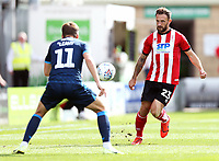 Lincoln City's Neal Eardley vies for possession with Bristol Rovers' Luke Leahy<br /> <br /> Photographer Rich Linley/CameraSport<br /> <br /> The EFL Sky Bet League One - Lincoln City v Bristol Rovers - Saturday September 14th 2019 - Sincil Bank - Lincoln<br /> <br /> World Copyright © 2019 CameraSport. All rights reserved. 43 Linden Ave. Countesthorpe. Leicester. England. LE8 5PG - Tel: +44 (0) 116 277 4147 - admin@camerasport.com - www.camerasport.com