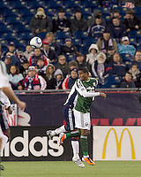 Portland Timbers midfielder Jeremy Hall (17) heads the ball. In a Major League Soccer (MLS) match, the New England Revolution tied the Portland Timbers, 1-1, at Gillette Stadium on April 2, 2011.