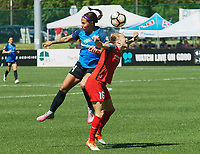 Kansas City, MO - Saturday May 13, 2017: Portland Thorns FC Emily Sonnett  and FC Kansas City  Sydney Leroux during a regular season National Women's Soccer League (NWSL) match between FC Kansas City and the Portland Thorns FC at Children's Mercy Victory Field.