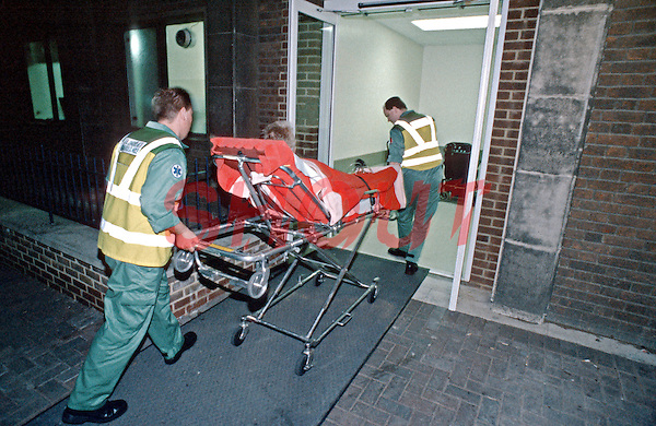 Paramedic ambulance crew taking a patient on a stretcher into hospital. This image may only be used to portray the subject in a positive manner..©shoutpictures.com..john@shoutpictures.com