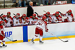 19 MAR 2016: Melissa Sheeran (26) of Plattsburgh is congratulated by her teammates after her goal during the Division lll Women's Ice Hockey Championship, held at the Ronald B. Stafford Ice Arena in Plattsburgh, NY. Plattsburgh defeated Wis.-River Falls 5-1 for the national title. Plattsburgh's Melissa Sheeran high fives teammates after scoring for the Cardinals. Photos Nancie Battaglia/NCAA Photos