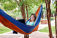 Anna Coleman, a sophomore biological sciences major from Starkville, studies for an upcoming summer session final exam in a hammock near Allen Hall. Final exams for second term summer classes end Thursday [Aug. 3], with the fall semester beginning Aug. 16.<br />  (photo by Camille Carskadon / &copy; Mississippi State University)