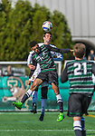 3 October 2015: University of Vermont Catamount Midfielder Charlie DeFeo, a Senior from Newfields, NH, jumps up for a header against Binghamton University Bearcat Forward Logan Roberts, a Junior from Syracuse, NY, during game action at Virtue Field in Burlington, Vermont. The Catamounts were unable to complete a late game rally, falling to the Bearcats 2-1 in America East conference play. Mandatory Credit: Ed Wolfstein Photo *** RAW (NEF) Image File Available ***