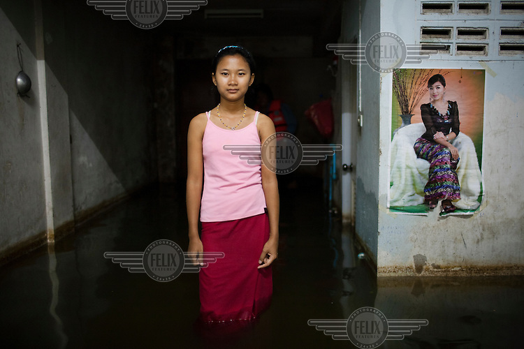 In the Northern city of Ayuthaya a young Buense girl ( NAME) stands in knee high flood water in the family house. Thailand's worst flooding in five decades, which has killed at least 356 people and affected nearly 2.5 million, with more than 100,000 people living in temporary shelters and about 700,000 seeking medical attention.