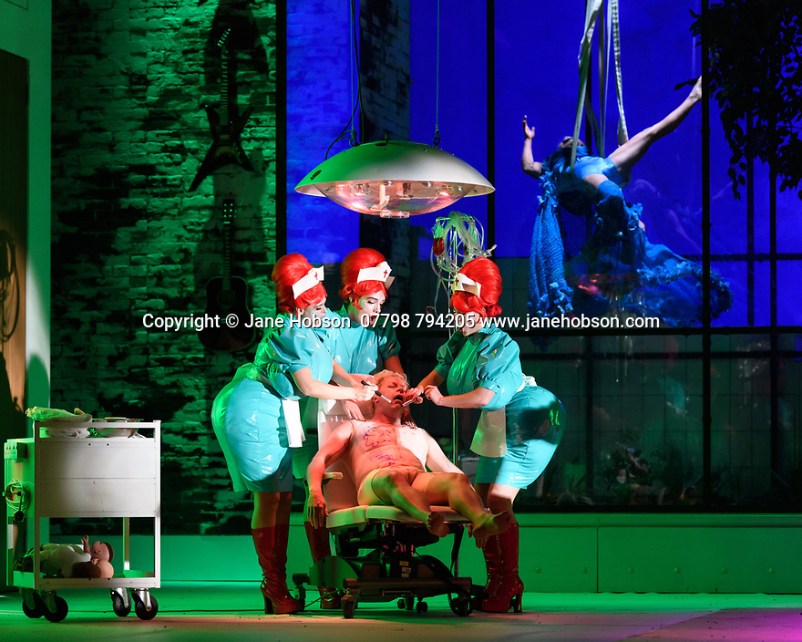 "EMBARGOED UNTIL 23:00 FRIDAY 18 OCTOBER 2019: London, UK. 16.10.2019.  English National Opera presents ""The Mask of Orpheus"", by Sir Harrison Birthwhistle, libretto by Peter Zinovieff, at the London Coliseum, in its first London restaging in the 30 years since its premiere, coinciding with the celebration of Sir Harrison's 85th birthday. Directed by Daniel Kramer, with lighting design by Peter Mumford, set design by Lizzie Clachan and costume design by Daniel Lismore. Picture shows: Charlotte Shaw (First Woman), Peter Hoare (Orpheus the Man), Katie Stevenson (Third Woman), Daniel Norman (Orpheus the Myth), Katie Coventry (Second Woman). Photograph © Jane Hobson."