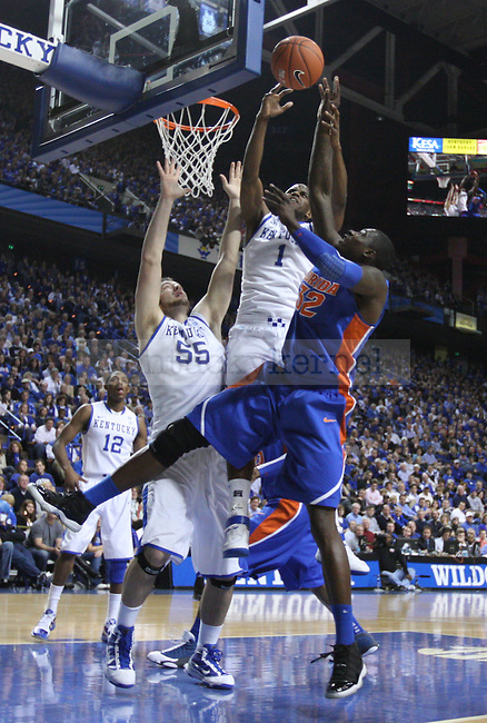 Darius Miller blocks a shot in the first half of UK vs. Florida  at Rupp Arena on Saturday, Feb. 26, 2011.  Photo by Britney McIntosh | Staff