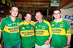 SUPPORTING: Showing their colours as they show their support for the Kerry teams in Tom McCarthy's Bar,Castleisland l-r: Bernard Nolan and Lyn Oztoby (Castleisland),Paddy Courtney (Currow) and Cian Brosnan (Castleisland).