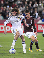 25 October 08: Real Salt Lake midfielder Kyle Beckerman (in white) dribbles the ball against Rapids defender Kosuke Kimera. Real Salt Lake tied the Colorado Rapids 1-1 at Dick's Sporting Goods Park in Commerce City, Colorado. The tie advanced Real Salt Lake to the playoffs.