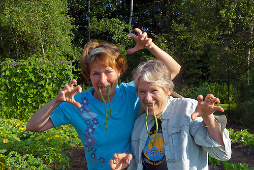 Two women demonstrate the fierce side of gardening, Yarmouth Maine