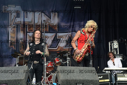 Thin Lizzy performing live 'Dancin' In The Moonlight' with Michael Monroe on saxophone on the Main Stage on Day One of the High Voltage Festival in London UK - 23 Jul 2011.  Photo credit: George Chin/IconicPix