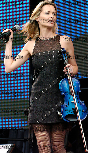 The Corrs - Sharon Corr - performing live at Capital FM's Party  in the Park in Hyde Park London UK - 11 Jul 2004.  Photo credit: George Chin/IconicPix
