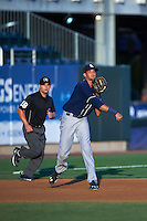 New Hampshire Fisher Cats third baseman Emilio Guerrero (13) throws to first as umpire Jorge Teran looks on during a game against the Harrisburg Senators on July 21, 2015 at Metro Bank Park in Harrisburg, Pennsylvania.  New Hampshire defeated Harrisburg 7-1.  (Mike Janes/Four Seam Images)