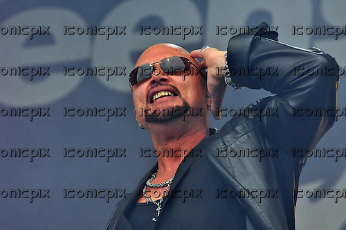 QUEENSRYCHE - vocalist Geoff Tate - performing live on the main stage on Day One of the High Voltage Festival in London UK - 23 Jul 2011.  Photo credit: George Chin/IconicPix
