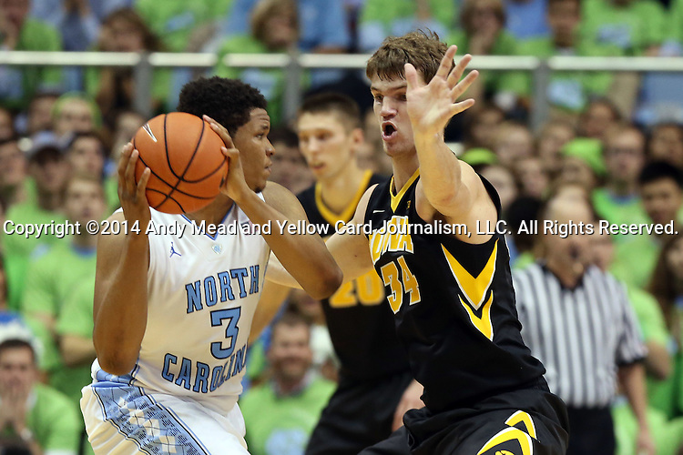 03 December 2014: Iowa's Adam Woodbury (34) guards North Carolina's Kennedy Meeks (3). The University of North Carolina Tar Heels played the University of Iowa Hawkeyes in an NCAA Division I Men's basketball game at the Dean E. Smith Center in Chapel Hill, North Carolina. Iowa won the game 60-55.