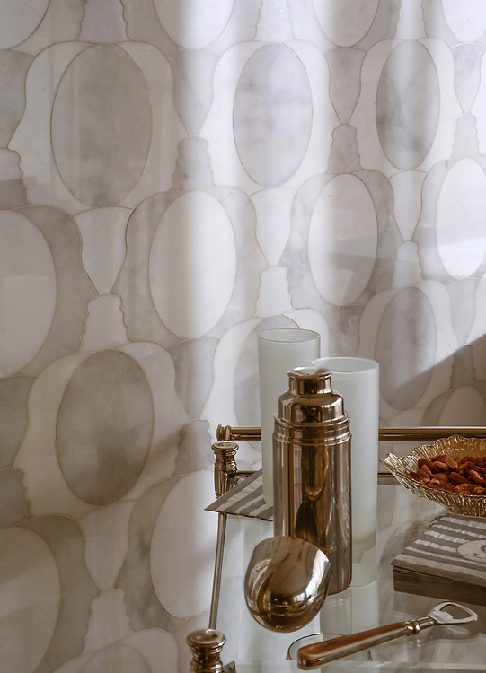 Janus, a waterjet mosaic shown in polished Carrara and Thassos, is part of the Illusions® collection by New Ravenna.