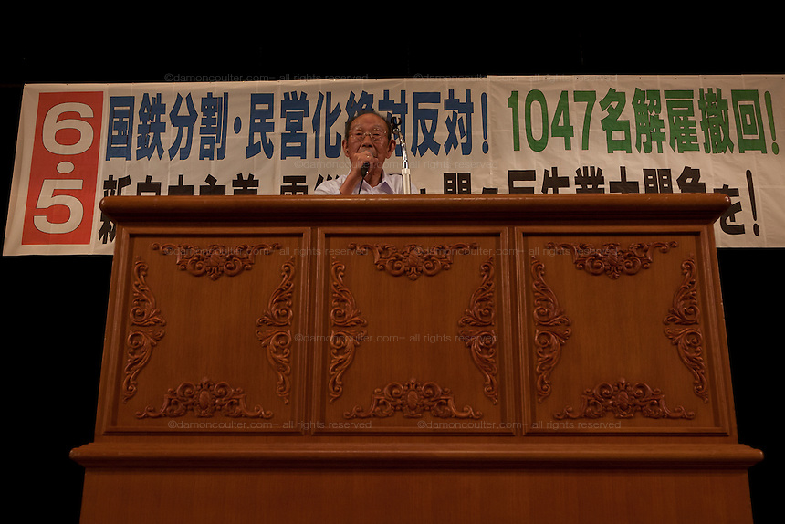 Kouji Kitahara, General secretary,Sanrizuka-Shibayama United Opposition League against Construction of Narita Airport speaks at a rally by left wing groups, including Doro Chiba railway Union and Zengakuren students union, in Hibiya Park Hall in support of the abolition of nuclear power after the disaster at Fukushima Daichi nuclear plant. Hibiya Park, Tokyo, Japan. Sunday June 5th 2011