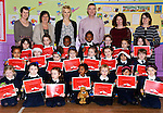The junior infants of St. Brigid's Girls National School with their Music Matters Certificates. The back row is (from left): Jean McFadden (principal), teachers Mary Collier and Donna Carolan, Hugh Doogan, Education Coordinator, Louth Leader Partnership, Gemma Murray and Claire McKenna of Music Generation Louth. www.newsfile.ie