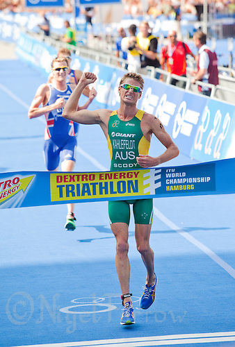 16 JUL 2011 - HAMBURG, GER - Brad Kahlefeldt (AUS) celebrates victory at the men's round of triathlon's ITU World Championship Series (PHOTO (C) NIGEL FARROW)