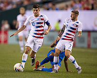 PHILADELPHIA, PA - JUNE 30: Christian Pulisic #10, Paul Arriola #7 and Shermaine Martina #15 all go for the ball during a game between Curaçao and USMNT at Lincoln Financial Field on June 30, 2019 in Philadelphia, Pennsylvania.
