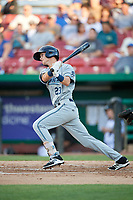 West Michigan Whitecaps shortstop Cam Warner (23) follows through on a swing during a game against the Kane County Cougars on July 19, 2018 at Northwestern Medicine Field in Geneva, Illinois.  Kane County defeated West Michigan 8-5.  (Mike Janes/Four Seam Images)