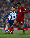 Aaron Connolly of Brighton tackled by Trent Alexander-Arnold of Liverpool during the Premier League match at Anfield, Liverpool. Picture date: 30th November 2019. Picture credit should read: Simon Bellis/Sportimage