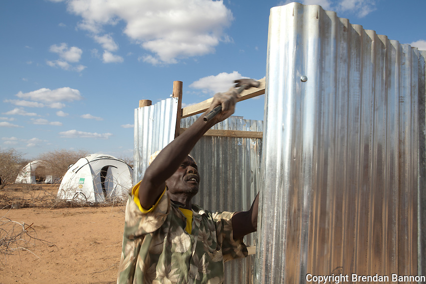 Workmen build a latrine in the newly opened Ifo extension. September 28, 2011. Dadaab, Kenya.