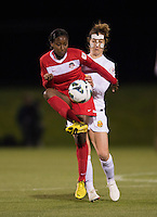 Kim Yokers (5) of the Western NY Flash fights for the ball with Tiffany McCarty (14) of the Washington Spirit during the game at the Maryland SoccerPlex in Boyds, MD.  Washington tied Western NY, 1-1.