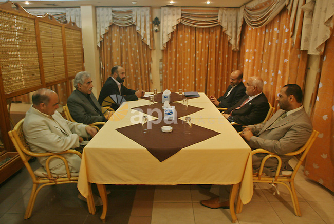 Palestinian Fatah officials (from front-L) Abdullah Abu Samhadana, Ibrahim Abu al-Naja and Ashraf Jomaa meet with Hamas officials Ayman Taha, Jamal Abu Hashem and Ismail al-Ashkar in Gaza city on June 14, 2009. The two main Palestinian factions Fatah and Hamas convened meetings in the West Bank and the Gaza Strip in a new bid to reconcile their differences, officials from both groups said. Photo\Thaer Mahmoud