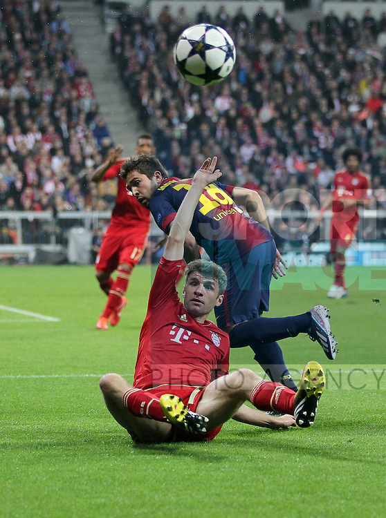 Munich's Thomas Muller tussles with Barcelona's Jordi Alba..Bayern Munich v Barcelona - Champions League, Semi Final 1st Leg- Allianz Arena, Munich- 23/04/13 - Picture David Klein/Sportimage
