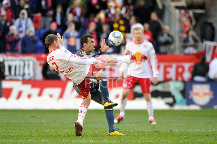 Teemu Tainio (2) of the New York Red Bulls and Juninho (19) of the Los Angeles Galaxy during the 1st leg of the Major League Soccer (MLS) Western Conference Semifinals at Red Bull Arena in Harrison, NJ, on October 30, 2011.
