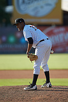 Kannapolis Intimidators relief pitcher Jose Nin (32) looks to his catcher for the sign against the Greensboro Grasshoppers at Kannapolis Intimidators Stadium on August 5, 2018 in Kannapolis, North Carolina. The Intimidators defeated the Grasshoppers 9-0 in game two of a double-header.  (Brian Westerholt/Four Seam Images)