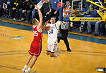 BROOKINGS, SD - FEBRUARY 23: David Wingett #50 of the South Dakota State Jackrabbits takes the ball to the basket against Tyler Hagedorn #25 of the South Dakota Coyotes Sunday at Frost Arena in Brookings, SD. (Photo by Dave Eggen/Inertia)