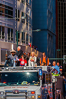 Super Bowl MVP Von Miller holds the Lombardi Trophy. Next to him is Peyton Manning's four year daughter, Mosley; Annabel Bowlen (wife of Broncos team owner Pat Bowlen)' behind is Peyton Manning and John Elway, Denver Broncos Super Bowl 50 Victory Parade, Downtown Denver, Colorado USA.