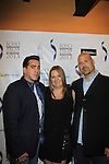 """Donna McKenna poses with Actor Anthony Mangano & Joe Basile (also is director and writer of this film) star in """"West End"""" a film by Joe Basile about Family, Betrayal, Revenge - Greeting from the Jersey Shore - with its premiere at the Soho International Film Festival on April 11, 2013 at the Sunshine Cinema, New York City, New York. (Photo by Sue Coflin/Max Photos)"""