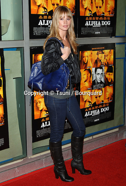 Cameron Richardson arriving at the ALPHA DOG Premiere at the Arclight Theatre in Los Angeles. January 3, 2007<br /> <br /> full length<br /> eye contact