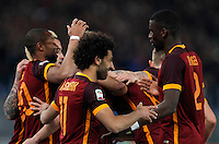 Calcio, Serie A: Roma vs Fiorentina. Roma, stadio Olimpico, 4 marzo 2016.<br /> Roma&rsquo;s Mohamed Salah, center, celebrates with teammates after scoring during the Italian Serie A football match between Roma and Fiorentina at Rome's Olympic stadium, 4 March 2016.<br /> UPDATE IMAGES PRESS/Riccardo De Luca