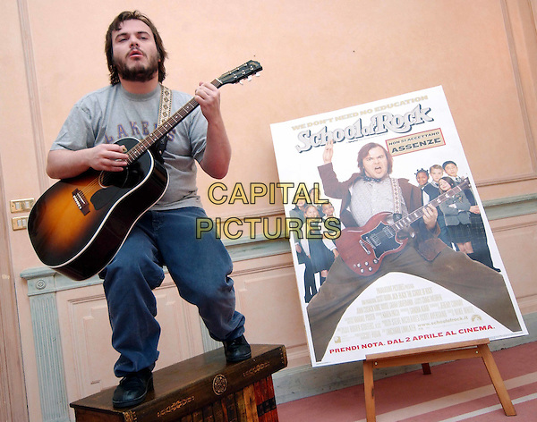 JACK BLACK.School Of Rock photocall in Rome.12 February 2004.full length, full-length, playing guitar, funny.www.capitalpictures.com.sales@capitalpictures.com.© Capital Pictures.