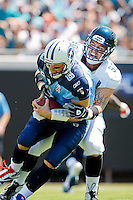 Sept 11, 2011:  Jacksonville Jaguars linebacker Matt Roth (90) sacks Tennessee Titans quarterback Matt Hasselbeck (8) on the first play of the game during action between the Jacksonville Jaguars and the Tennessee Titans at EverBank Field in Jacksonville, Florida.   ........