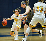 RAPID CITY, SD: DECEMBER 1:  Julia Seamans #3 of Black Hills State drives toward Sami Steffeck #2 of South Dakota Mines during their Rocky Mountain Athletic Conference women's basketball game Saturday evening at the King Center Rapid City, S.D.  (Photo by Richard Carlson/dakotapress.org)