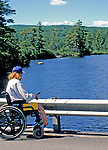 Wheelchaired Veteran fishing one of the bridges along Castle Island Road, Belgrade Lakes, Maine