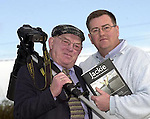 Killarney press photographer Don MacMonagle, right,  pictured at the launch of his photographic book on Jackie Healy-Rae TD in Killarney last evening (Friday). The book, 'Jackie-Keeping Up Appearances' features over 100 colour photographs of the deputy taken during 1997-2002 recording his five years as an independent.<br />