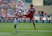 Chicago midfielder Marco Pappa (16) goes up high for the ball while New York midfielder Joel Lindpere (20) puts up his hands to protect himself.  The Chicago Fire tied the New York Red Bulls 1-1 at Toyota Park in Bridgeview, IL on June 26, 2011.