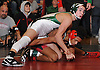 Jon Gomez of Locust Valley, left, battles Frankie Paulino of Freeport at 120 pounds during the final round of the 2016 Ted Petersen Tournament at Island Trees High School on Saturday, Jan. 2, 2016. Gomez won by technical fall 25-9.