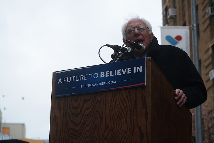 President hopeful Bernie Sanders speaks at a rally in front of his old apartment building in Midwood, Brooklyn.